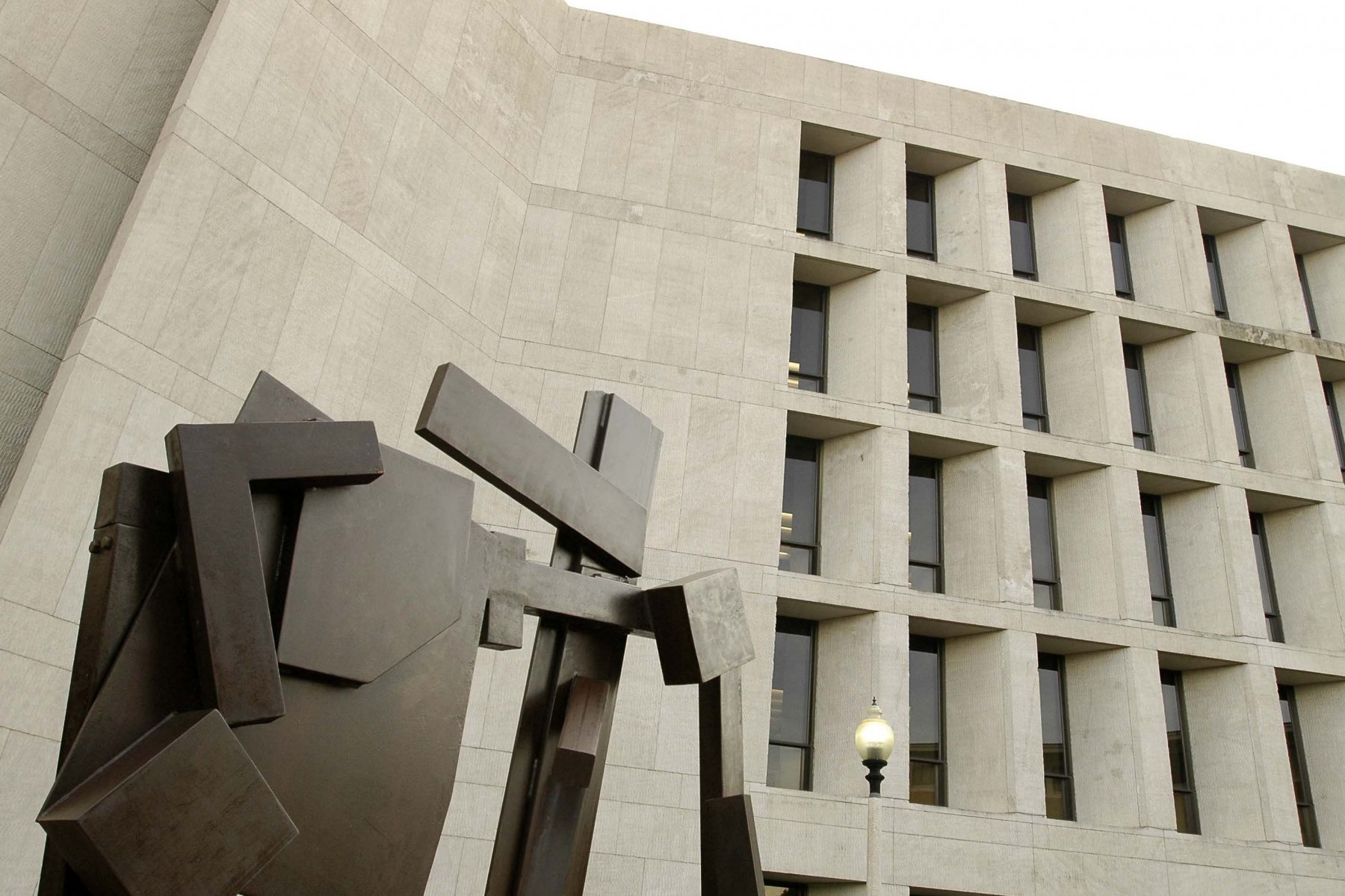 metal sculpture up against building