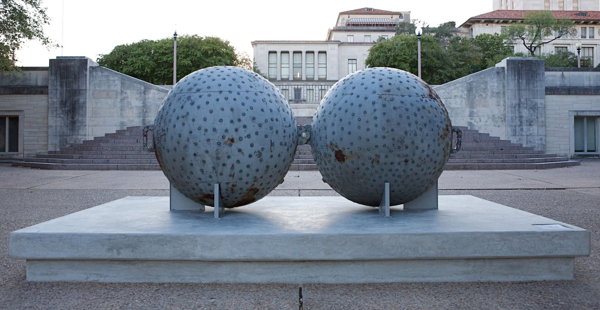 Two large spheres with pennies affixed