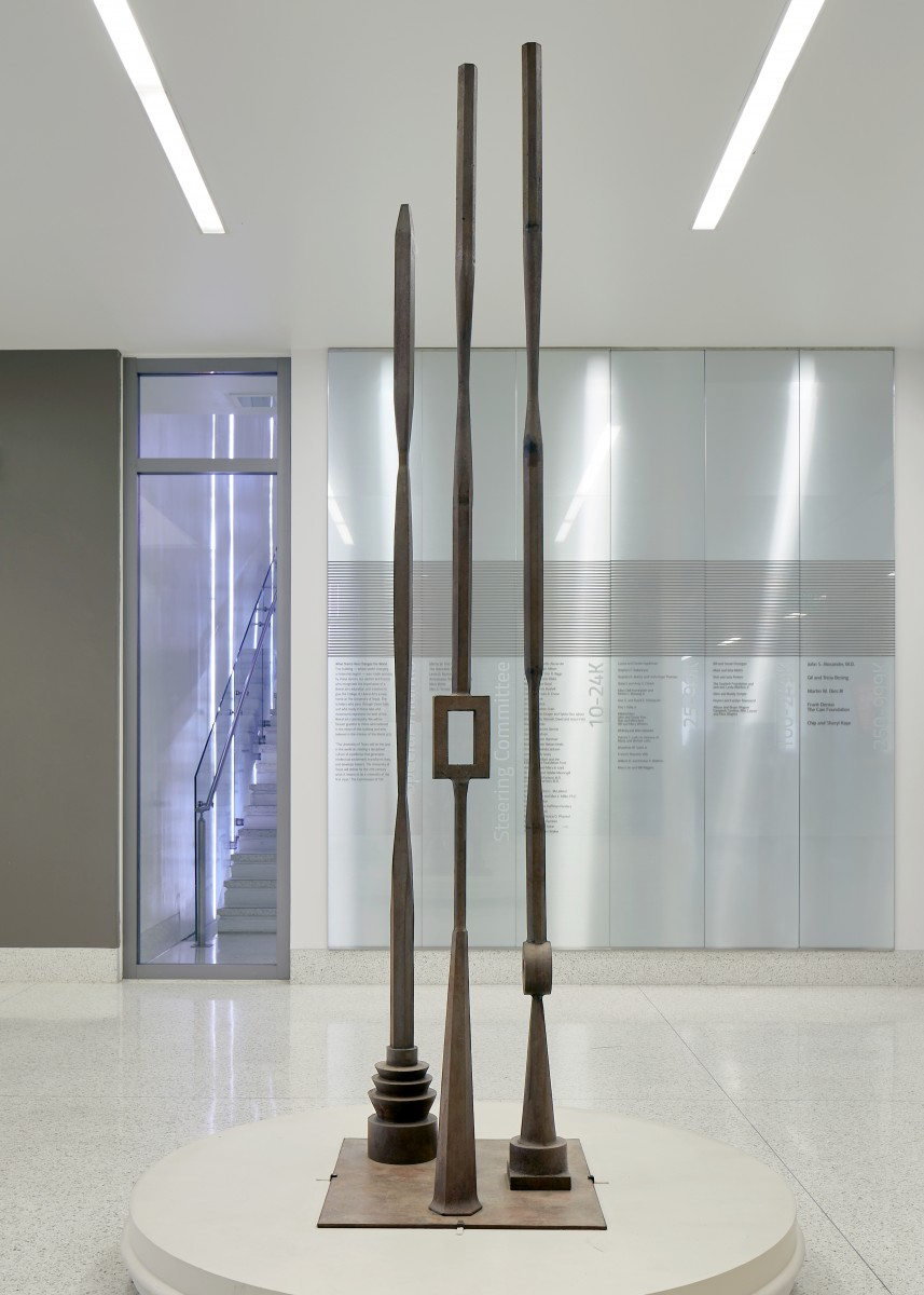 Tall sculpture with three large vertical poles