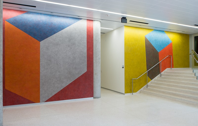 two walls with colorful shapes on it