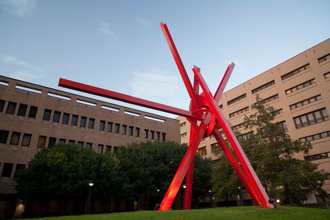 A large red metal sculpture