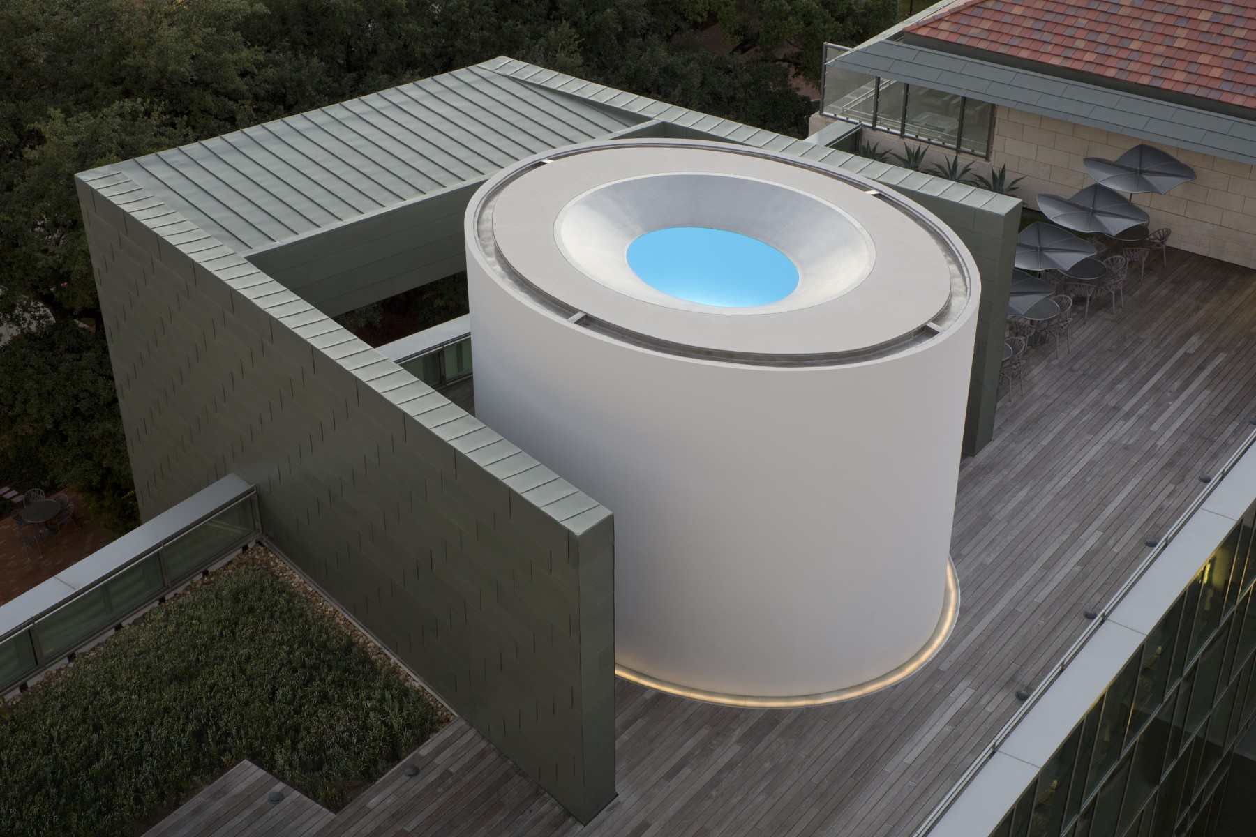 birds eye view of circular building with blue inside