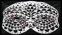 white shaped mask on black background