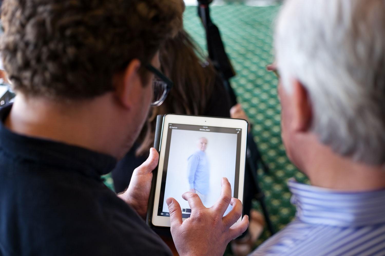 Two men looking at an iPad