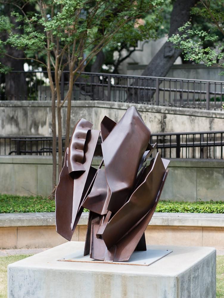 metal sculpture set on base