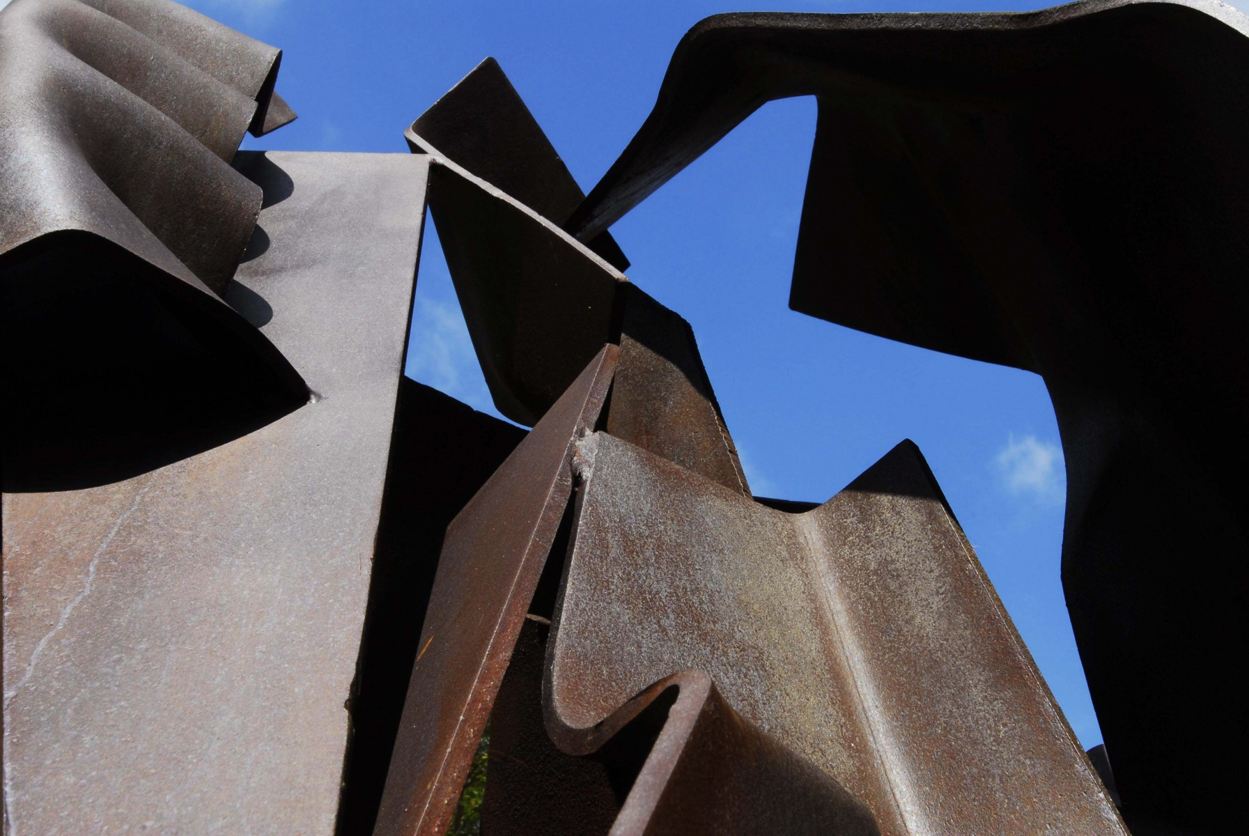 Close up of sculpture with blue sky showing through spaces