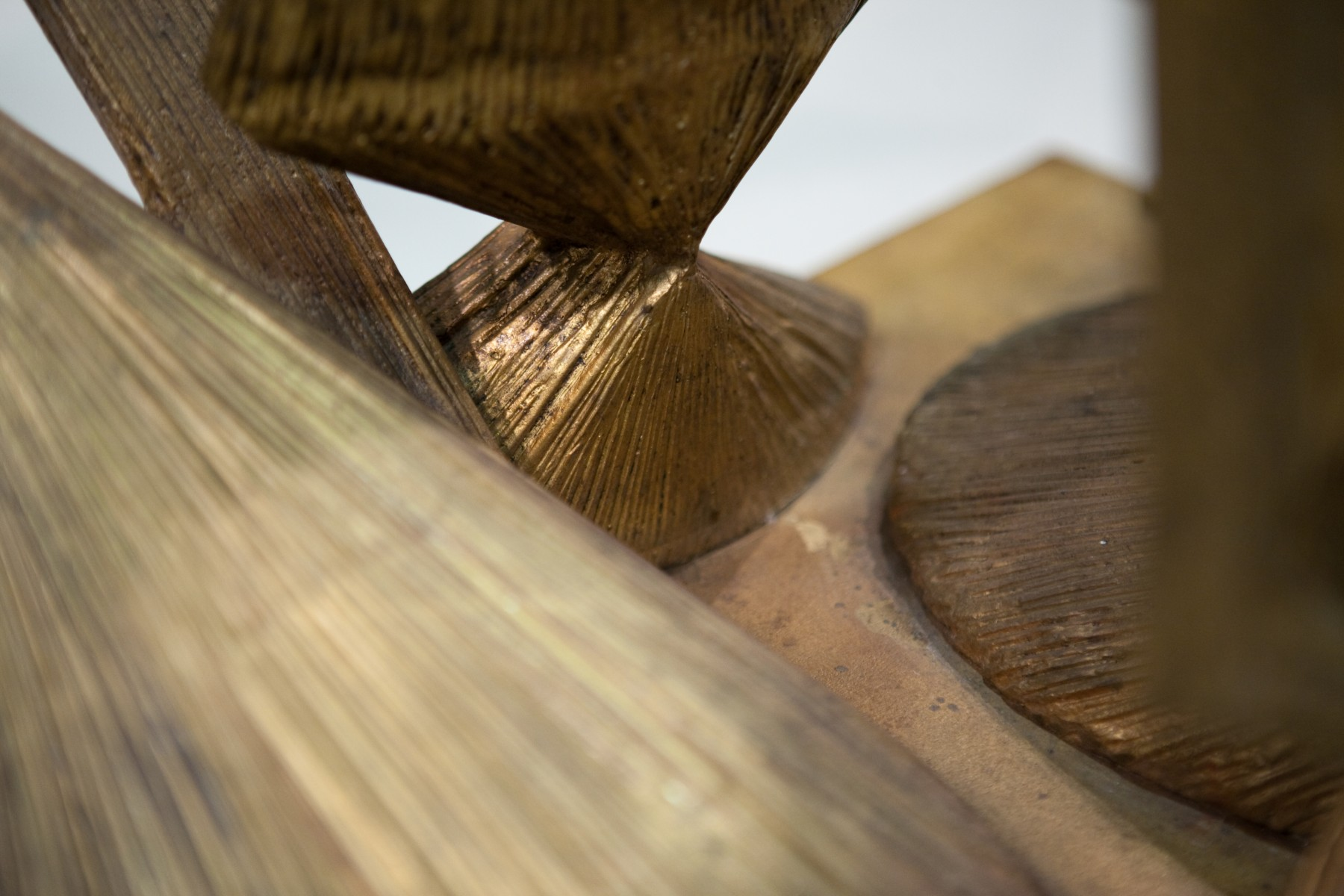 detail of textured wooden sculpture with lines going different directions