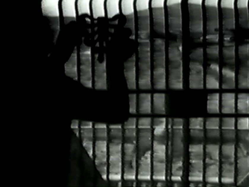 A man putting a bow-like object on a gate